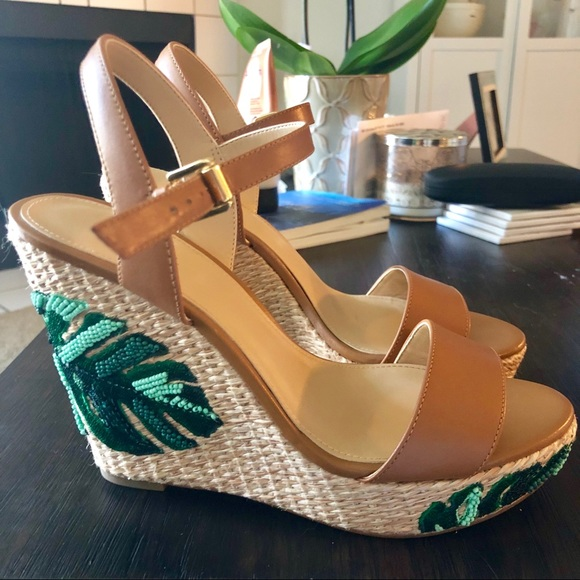 0c8c99ca2cd Michael Kors Fisher Palm Embroidered Wedge. M 5b68cbc30cb5aa2d3063e98a